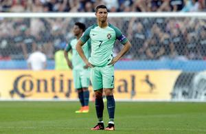 Portugal's Cristiano Ronaldo reacts after Hungary scored their second goal during the Euro 2016 Group F soccer match between Hungary and Portugal at the Grand Stade in Decines-Charpieu, near Lyon, France, Wednesday, June 22, 2016. (AP Photo/Pavel Golovkin)