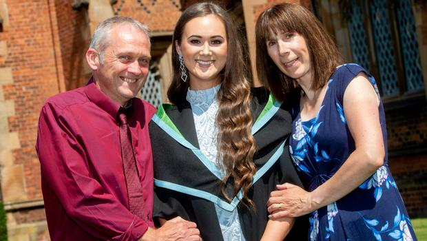 Graduating today from Queen's University Belfast with a degree in Psychology, from the School of Psychology is Rachel McMullan from Banbridge. Rachel is pictured with her parents, Alister and Dawn.