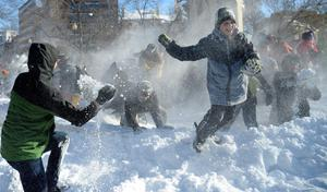 People participate in a giant snowball fights in Dupont Circle  in Washington on January 24, 2016. Snowball fights have become a tradition after every major snow storm in the Nation's Capital. A massive blizzard that claimed at least 16 lives in the eastern United States finally appeared to be winding down Sunday, giving snowbound residents the chance to begin digging out.  AFP / Olivier DoulieryOLIVIER DOULIERY/AFP/Getty Images