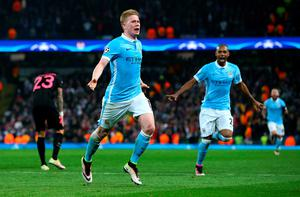MANCHESTER, UNITED KINGDOM - APRIL 12:  Kevin de Bruyne of Manchester City celebrates with Fernandinho as he scores their first goal during the UEFA Champions League quarter final second leg match between Manchester City FC and Paris Saint-Germain at the Etihad Stadium on April 12, 2016 in Manchester, United Kingdom.  (Photo by Alex Livesey/Getty Images)