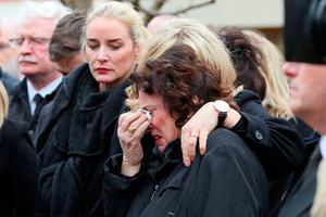 Martin McGuinness's wife Bernadette (Bernie) is comforted ahead of the funeral of former Northern Ireland Deputy First Minister Martin McGuinness, outside his home in the Bogside area of Derry, Northern Ireland on March 23, 2017. Former Irish Republican Army commander turned peace negotiator Martin McGuinness divided opinion both in life and in death but on Thursday his supporters gave him the funeral of an Irish chieftain. / AFP PHOTO / POOL / Paul FAITHPAUL FAITH/AFP/Getty Images