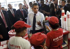 """US President Barack Obama orders lunch at a """"Five Guys"""" burgers and fries restaurant in Washington, DC"""