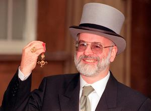 File photo dated 26/11/98 of bestselling author Sir Terry Pratchett with his OBE, as it has been announced that he has died aged 66.