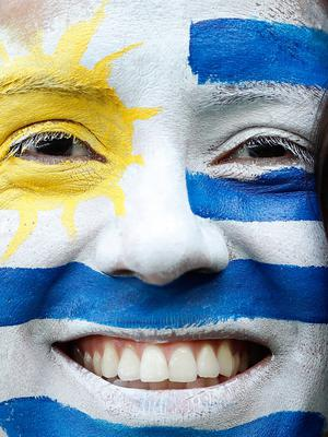A Uruguay soccer fan smiles ahead of the group A match between Uruguay and Russia at the 2018 soccer World Cup at the Samara Arena in Samara, Russia, Monday, June 25, 2018. (AP Photo/Hassan Ammar)