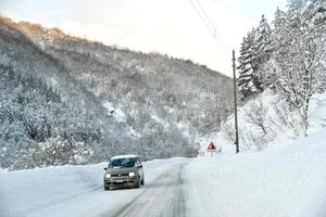 A car drives along the main road to Monterale, after a 5.7-magnitude earthquake struck the region, on January 19, 2017. Several people have died after a ski hotel was buried by an avalanche in earthquake-hit central Italy, local media reported quoting rescue services. / AFP PHOTO / ANDREAS SOLAROANDREAS SOLARO/AFP/Getty Images
