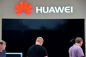Workers perpare the booth of Chinese electronics giant Huawei ahead of the opening of the 55th IFA (Internationale Funkausstellung), on September 2, 2015 in Berlin. IFA, one of the world's biggest consumer electronics shows, opens for the media before the public is invited from September 4 to 9. AFP PHOTO / JOHN MACDOUGALLJOHN MACDOUGALL/AFP/Getty Images