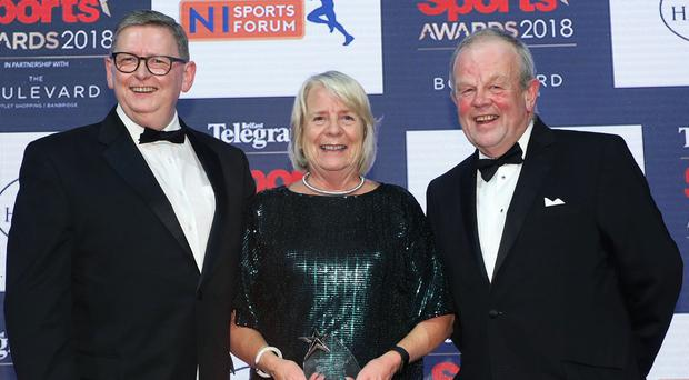 Terry Crothers receives the Paddy Patterson Award from Richard Johnston, NI Sports Forum Chair and Norman McBride, Hasting Hotels at the 2018 Belfast Telegraph Sports Awards.