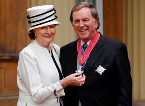 Sir Terry Wogan with his wife Lady Helen, after the radio and television presenter collected his knighthood from Queen Elizabeth II in 2005