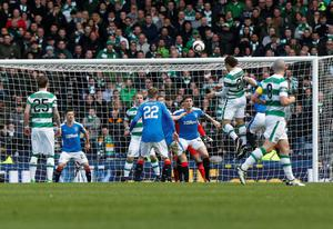 Celtic's Erik Sviatchenko scores his sides opening goal during the William Hill Scottish Cup semi-final match at Hampden Park, Glasgow. PRESS ASSOCIATION Photo. Picture date: Sunday April 17, 2016. See PA story SOCCER Rangers. Photo credit should read: Danny Lawson/PA Wire. EDITORIAL USE ONLY