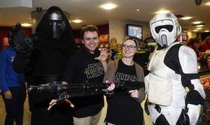 "Pacemaker press 16/12/2015 Hundreds of Star Wars fans queue outside the Movie House on the Dublin road in order to see the latest  film "" The Force Awakens"". Pictured are Hollie Walsh and Hamish Calvert. Picture Mark Marlow/pacemaker press"