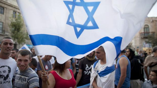 JERUSALEM, ISRAEL - JULY 14: (ISRAEL OUT)  Right wing Israelis demostrate in support of Israel's operration in the Gaza Strip on July 14, 2014 in Jerusalem, Israel. Israel's operation 'Protective Edge' is in its seventh day with the Israel Defense Forces (IDF) carrying out massive airstrikes across the Gaza Strip. Reports say at least 170 people have been killed in Gaza, with the majority being civilians.  (Photo by Lior Mizrahi/Getty Images)
