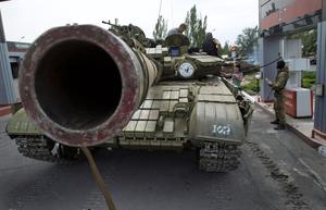 Donetsk People's Republic fighters fill their tank with fuel at a gas station in Snizhne, 100 kilometers east of Donetsk, eastern Ukraine Thursday, July 17, 2014. (AP Photo/Dmitry Lovetsky)