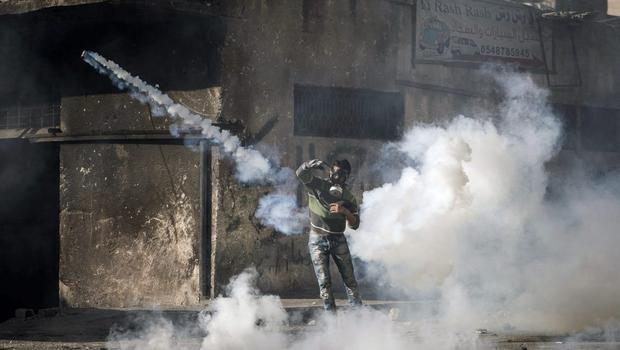 Palestinian youth clash with police at Shuafat refugee camp a day after a Palestinian resident of the camp was named as the driver of a van that rammed into a crowd at a rail stop on November 6, 2014 in Jerusalem, Israel. (Photo by Ilia Yefimovich/Getty Images)