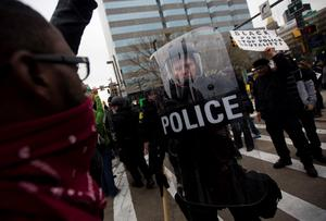 Protesters yell at riot police during a demonstration in Baltimore, Maryland, on April 25, 2015, against the death of Freddie Gray while in police custody. Protesters targeted businesses and smashed police cars in downtown Baltimore on Saturday as the biggest demonstration yet over the death of Gray in police custody turned violent.  AFP PHOTO / ANDREW CABALLERO-REYNOLDSAndrew Caballero-Reynolds/AFP/Getty Images