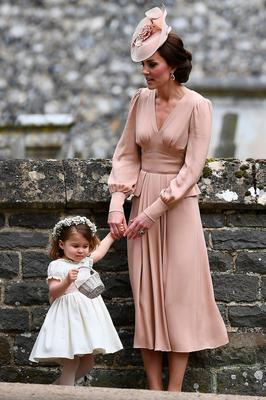 Britain's Catherine, Duchess of Cambridge (R) stands with her daughter Britain's princess Charlotte, a bridesmaid, following the wedding of her sister Pippa Middleton to James Matthews at St Mark's Church in Englefield, west of London, on May 20, 2017. After turning heads at her sister Kate's wedding to Prince William, Pippa Middleton graduated from bridesmaid to bride on Saturday at a star-studded wedding in an English country church. The 33-year-old married financier James Matthews, 41, at a ceremony attended by the royal couple and tennis star Roger Federer, wearing a couture dress by British designer Giles Deacon.  / AFP PHOTO / POOL AND AFP PHOTO / Justin TALLISJUSTIN TALLIS/AFP/Getty Images