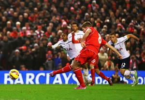 Steven Gerrard of Liverpool scores from the penalty spot during the Barclays Premier League match between Liverpool and Tottenham Hotspur at Anfield on February 10, 2015 in Liverpool, England.  (Photo by Clive Brunskill/Getty Images)