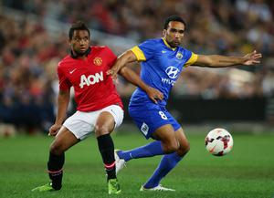 SYDNEY, AUSTRALIA - JULY 20:  Anderson of Manchester United challenges Paul Ifill of the All-Stars during the match between the A-League All-Stars and Manchester United at ANZ Stadium on July 20, 2013 in Sydney, Australia.  (Photo by Matt King/Getty Images)