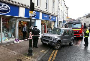 PSNI and emergency services at the  scene on Townhall street in Enniskillen where a vehicle collided with members of the public.