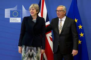 European Commission President Jean-Claude Juncker, right, greets British Prime Minister Theresa May prior to a meeting at EU headquarters in Brussels on Monday, Dec. 4, 2017. British Prime Minister Theresa May and EU Commission President Jean-Claude Juncker will hold a power lunch on Monday, seeking a breakthrough in the Brexit negotiations ahead of a key EU summit the week after. (AP Photo/Virginia Mayo)