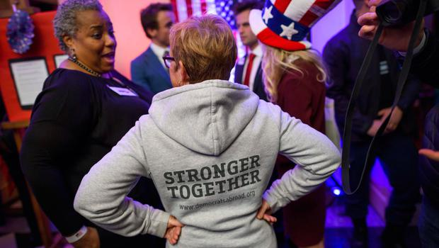 Supporters of Democrat candidate attend the US Election Night Celebrations in Switzerland in Geneva, on November 8, 2016. America's future hung in the balance on November 8, 2016 as millions of eager voters cast ballots to elect Democrat Hillary Clinton as their first woman president, or hand power to the billionaire populist Donald Trump. / AFP PHOTO / FABRICE COFFRINIFABRICE COFFRINI/AFP/Getty Images