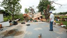 SHAWNEE, OK - MAY 20:  Lonnie Langston stands near his garage that was swept off the concrete pad next to his house by a tornado May 20, 2013 near Shawnee, Oklahoma. A series of tornados moved across central Oklahoma May 19, killing two people and injuring at least 21. (Photo by Brett Deering/Getty Images)