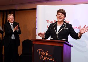 BELFAST, NORTHERN IRELAND - DECEMBER 17:  The new DUP leader Arlene Foster (R) is congratulated by outgoing leader Peter Robinson (L) at the Park Avenue hotel after the Democratic Unionist Party electoral college meeting on December 17, 2015 in Belfast, Northern Ireland. Arlene Foster succeeds Peter Robinson and becomes the first female leader of the Democratic Unionist Party. No other nominations were put forward for the role of leader. Mrs Foster will also be appointed as the new Northern Ireland first minister in the coming weeks. The former Ulster Unionist Party member has enjoyed a rapid rise through the ranks of the DUP following her defection in 2004, twice standing in as temporary first minister for Peter Robinson in times of personal and political crisis. The DUP remain the largest political party within the provinces' Executive government.  (Photo by Charles McQuillan/Getty Images)