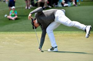 Northern Ireland's Rory McIlroy collects his ball on the 2nd green during Round 1 of the 80th Masters Golf Tournament at the Augusta National Golf Club on April 7, 2016, in Augusta, Georgia.   / AFP PHOTO / Nicholas KammNICHOLAS KAMM/AFP/Getty Images
