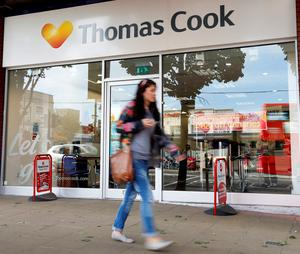 Thomas Cook warned their earnings could be hit by the combined impact of the terrorist atrocity in Tunisia, the Greek debt crisis and the weakening of the euro Photo credit should read