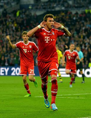 LONDON, ENGLAND - MAY 25:  Mario Mandzukic of Bayern Muenchen celebrates after scoring a goal during the UEFA Champions League final match between Borussia Dortmund and FC Bayern Muenchen at Wembley Stadium on May 25, 2013 in London, United Kingdom.  (Photo by Shaun Botterill/Getty Images)