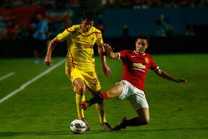 Jose Enrique #3 of Liverpool is challenged by (R) Ander Herrera #21 of Manchester United  in the Guinness International Champions Cup 2014 Final at Sun Life Stadium on August 4, 2014 in Miami Gardens, Florida.  (Photo by Chris Trotman/Getty Images)