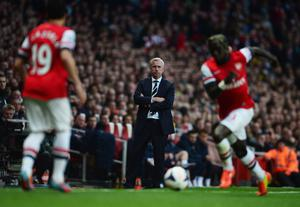 LONDON, ENGLAND - APRIL 28:  The returning Alan Pardew manager of Newcastle United looks on from the touchline after his ban during the Barclays Premier League match between Arsenal and Newcastle United at Emirates Stadium on April 28, 2014 in London, England.  (Photo by Jamie McDonald/Getty Images)