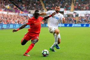 "Swansea City's Jordi Amat and Liverpool's Sadio Mane (left) battle for the ball during the Premier League match at the Liberty Stadium, Swansea. PRESS ASSOCIATION Photo. Picture date: Saturday October 1, 2016. See PA story SOCCER Swansea. Photo credit should read: Nigel French/PA Wire. RESTRICTIONS: EDITORIAL USE ONLY No use with unauthorised audio, video, data, fixture lists, club/league logos or ""live"" services. Online in-match use limited to 75 images, no video emulation. No use in betting, games or single club/league/player publications."