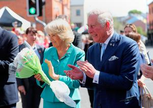 DROMORE, UNITED KINGDOM - MAY 10: Prince Charles, Prince of Wales and Camilla, Duchess of Cornwall listen to a band  in Dromore Village during a visit to Northern Ireland on May 10, 2017 in Dromore, Northern Ireland. (Photo by Niall Carson - WPA Pool/Getty Images)
