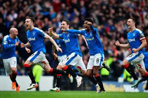 GLASGOW, SCOTLAND - APRIL 17:  Rangers players celebtate after beating Celtic in a penalty shoot out during the William Hill Scottish Cup semi final between Rangers and Celtic at Hampden Park on April 17, 2016 in Glasgow, Scotland.  (Photo by Jeff J Mitchell/Getty Images)
