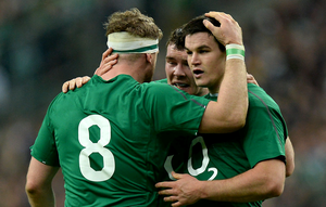 Ireland's Jonathan Sexton (right) celebrates with team mate Jamie Heaslip (left) after he scores his second and their side's third try during the Six Nations match at the Stade de France, Paris, France.
