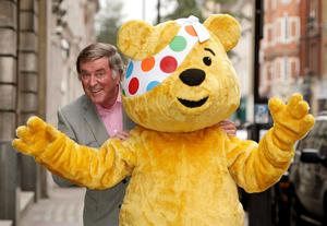 Sir Terry Wogan with Pudsey the bear during a Children in Need photo call in 2008