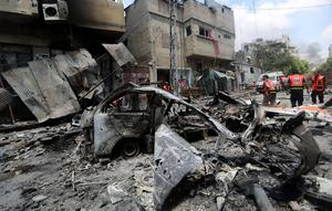 Palestinians medic inspect the damage in Gaza City's Shijaiyah neighborhood that came under fire as Israel widened its ground offensive against Hamas in the northern Gaza Strip on Sunday, July 20, 2014.  (AP Photo/Hatem Moussa)