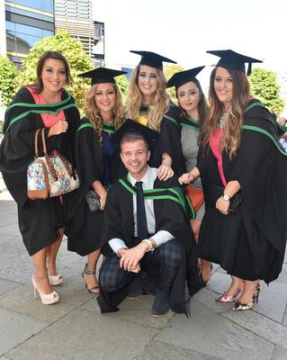 Ulster University Graduations-Waterfront Hall 03-07-15 Melissa Crossley, Bronagh Conwell, Shauna Brittain, Claire Whitley, Hanna Hamilton and Jamie Gilmore who graduated in International Hospitality Management. Photo by Simon Graham/Harrison Photography