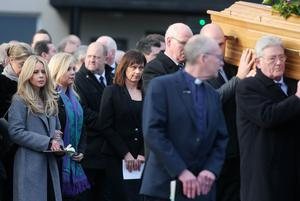 Press Eye - Belfast - Northern Ireland - 14th January 2018  Funeral for former Belfast Lord Mayor Dr Ian Adamson at Conlig Presbyterian Church in Co. Down.  The 74-year-old who died last week was a Ulster Unionist Party politician, medical doctor and historian, Dr Adamson served as Lord Mayor of Belfast in 1996/7, high sheriff in 2011 and was an Assembly member for the constituency of East Belfast from 1998 to 2003.  Dr Adamson's wife Kerry follows his coffin as it leaves the church after the service.   Picture by Jonathan Porter/PressEye