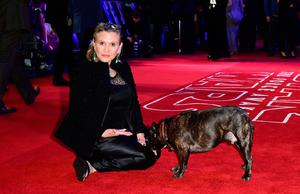 File photo dated 16/12/2015 of Carrie Fisher Carrie Fisher with her dog Gary as she arrives to the Star Wars: The Force Awakens European Premiere, as the actress has died at age 60, her daughter's publicist said. PRESS ASSOCIATION Photo. Picture date: Tuesday December 27, 2016. See PA story DEATH Fisher. Photo credit should read: Ian West/PA Wire