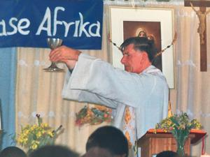 Fr Desmond Curran conducting mass in Khayelitsha township, South Africa, in the 1990s.