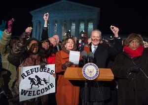 Senate Minority Leader Chuck Schumer (2nd R), Democrat of New York, US House Democratic Leader Nancy Pelosi (C), speak alongside other members of Congress as demonstrators protest against US President Donald Trump and his administration's ban of travelers from 7 countries by Executive Order, during a rally outside the US Supreme Court in Washington, DC, on January 30, 2017. Trump's executive order suspended the arrival of all refugees for at least 120 days, Syrian refugees indefinitely -- and bars citizens from Iran, Iraq, Libya, Somalia, Sudan, Syria and Yemen for 90 days.  Protests are taking place at airports across the country in opposition to the ban. / AFP PHOTO / SAUL LOEBSAUL LOEB/AFP/Getty Images