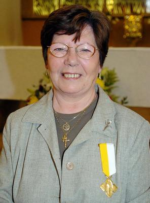 Annie Maguire wears the Bene Merenti medal that was presented to her by the Archbishop of Westminster, Cardinal Cormac Murphy-O'Connor at the Sacred Heart of Jesus in Kilburn , north-west London, Sunday May 22, 2005.