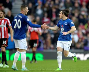 Everton's Leighton Baines (right) celebrates scoring his sides first goal of the game with teammate Ross Barkley during the Barclays Premier League match at the Stadium of Light, Sunderland. Owen Humphreys/PA Wire.
