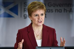Nicola Sturgeon has said she could delay lifting restrictions in Scotland (Jeff J Mitchell/PA)