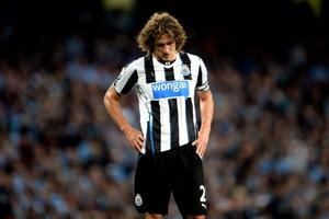 MANCHESTER, ENGLAND - AUGUST 19:  A dejected Fabricio Coloccini of Newcastle United looks on as his team concede two first half goals during the Barclays Premier League match between Manchester City and Newcastle United at the Etihad Stadium on August 19, 2013 in Manchester, England.  (Photo by Michael Regan/Getty Images)
