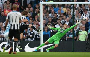 MANCHESTER, ENGLAND - AUGUST 19:  David Silva of Manchester City scores the first goal past Tim Krul of Newcastle United during the Barclays Premier League match between Manchester City and Newcastle United at the Etihad Stadium on August 19, 2013 in Manchester, England.  (Photo by Clive Brunskill/Getty Images)