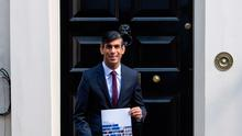 Chancellor of the Exchequer Rishi Sunak holds a copy of his Winter Economy Plan outside No 11 Downing Street before heading for the House of Commons. Credit: Dominic Lipinski/PA Wire