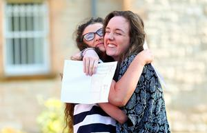 Picture - Kevin Scott / Belfast Telegraph  Belfast - Northern Ireland - Thursday 13th August 2015 - A Level Results Day   Pictured is Niamh Bunting and Dominique Groves during A level results day at St Dominics  Picture - Kevin Scott / Belfast Telegraph