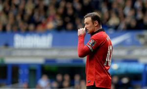 Manchester United's Wayne Rooney looks on dejected during the Barclays Premier League match at Goodison Park, Liverpool.